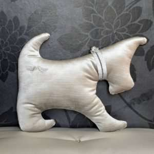 Small cushion dog Westie shape. Silver gray velvet with two embroidered birds and a silver and black ribbon around the neck.