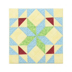 Textile Art Canvas Quadrille No 9. Quilt block with green, blue, yellow, red triangles, and squares.