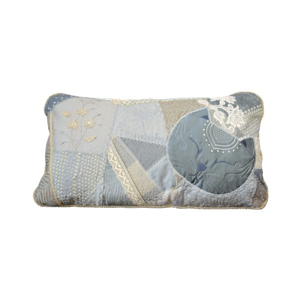 Textile art cushion Sybelle. Rectangular cushion of a sleeping cat made of pale blue quilt with different fabrics and ornaments
