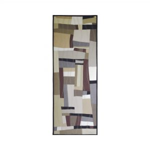 Piece of textile art A day will be. Vertical rectangle of geometric abstract art. Pieces of fabrics of different sizes and shapes in a neutral color palette: beige, brown, gray, black and white.