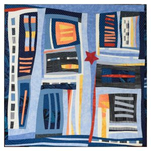 Textile art piece You are here. Geometric abstract art with horizontal and vertical fabric bands. Colors: different shades of blue in majority, orange, yellow, red.