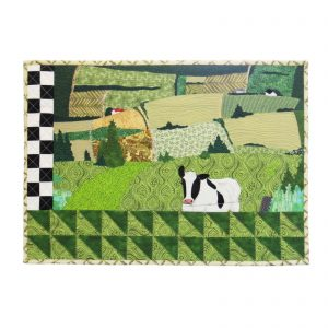 Piece of textile art The 3rd road. View of fields in the valleys of the Appalachian countryside with a white and black cow in the foreground.