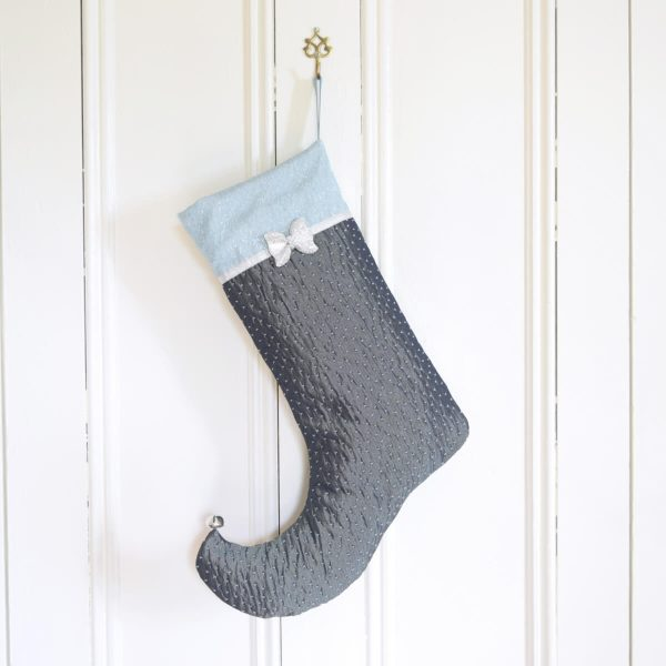 Christmas Stocking Sparkle with dark turquoise and pale turquoise textured fabrics with bow and silver ribbon.