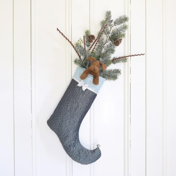 Christmas stocking Sparkle, Christmas decoration with a soft toy and fir branches.