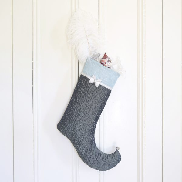 Christmas Stocking Sparkle, an elf stocking in turquoise textured fabrics with decorations inside.