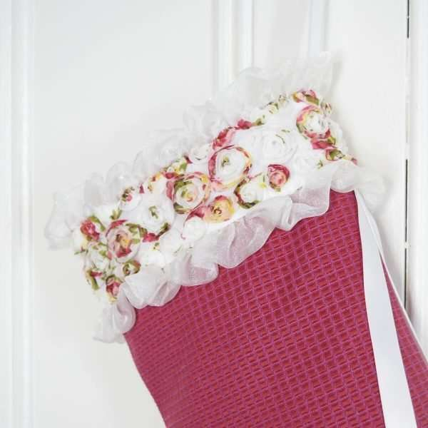 Detail of the Christmas stocking Flora, organza flowers with ruffles and ribbons.