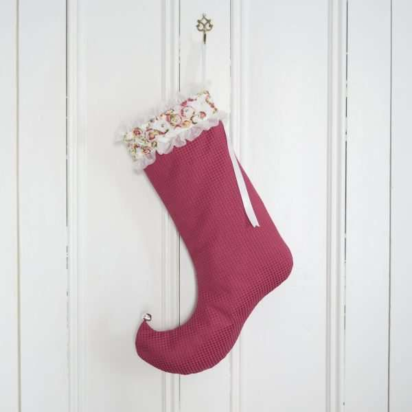Christmas stocking Flora in dark pink textured fabric with organza flowers and ribbons.