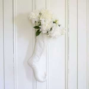 White elf stocking Snowdrop garnished with a bouquet of white peonies.