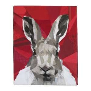 Textile art Nice to meet you, a rabbit made with a mosaic of pieces of fabric on a red background.