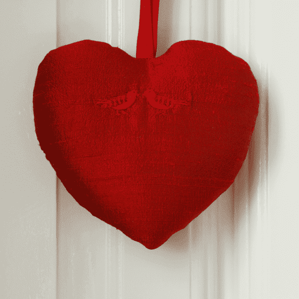 Red silk heart with two red embroidered birds.