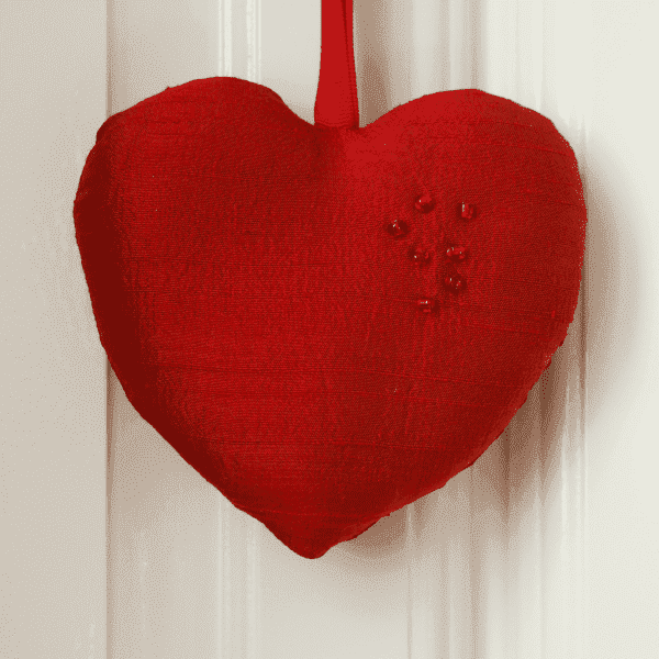 Red silk heart with red beads