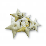 Set of 5 gold star cushions of different sizes.
