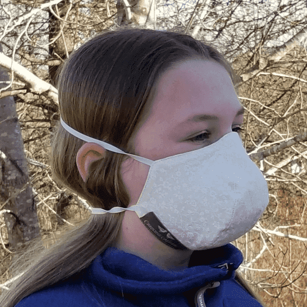 Girl wearing facial mask in ivory floral fabric.