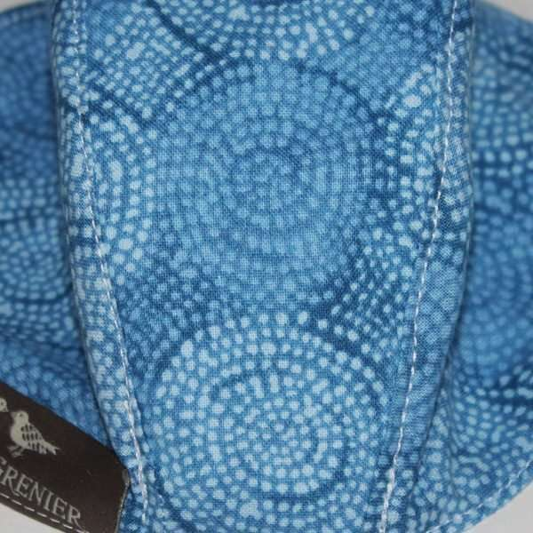 Tonal blue fabric, pattern of concentric circles like a mosaic