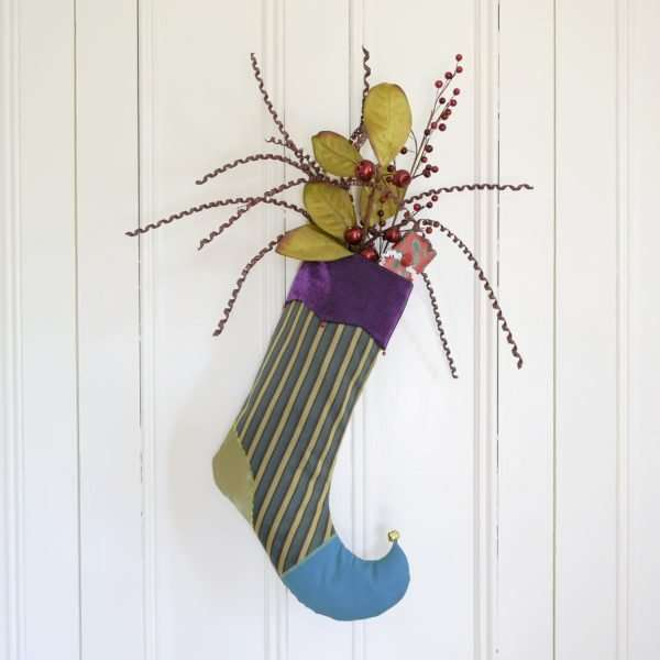 Elf stocking jester decorated with decorative items